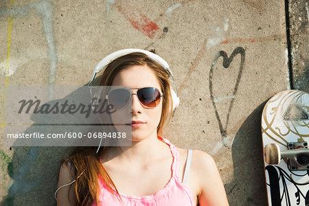 Teenager wearing Headphones in Skatepark, Feudenheim, Mannheim, Baden-Wurttemberg, Germany