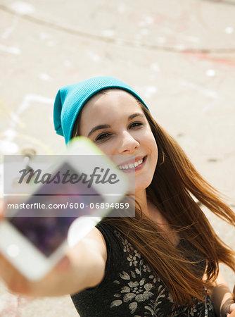 Teenage Girl taking Self Portrait in Skatepark, Feudenheim, Mannheim, Baden-Wurttemberg, Germany
