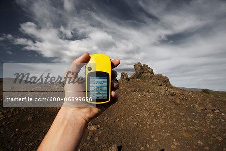 Hand Holding Yellow GPS Navigator, Reykjanes, Iceland