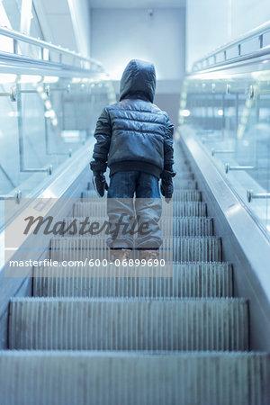 Young Boy Standing on Escalator in Metro, Copenhagen, Denmark