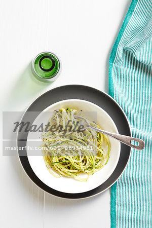 Overhead View of Spaghetti with Zucchini, Black Pepper, and Pecorino Cheese, Studio Shot