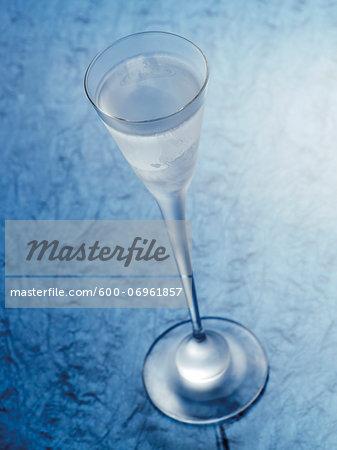 Glass of Aquavit on Blue Background, Studio Shot