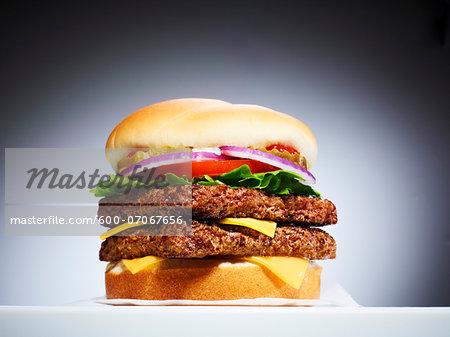 Close-up of Double Cheeseburger, Studio Shot