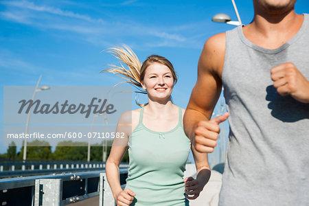 Young Couple Running, Worms, Rhineland-Palatinate, Germany