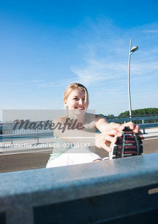 Young Woman Stretching, Worms, Rhineland-Palatinate, Germany