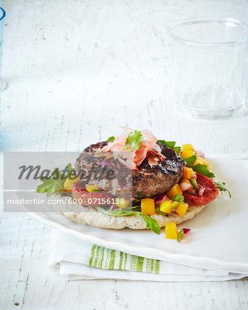 Fresh Burger on plate, studio shot
