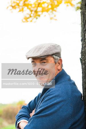 Senior Man leaning against Tree, Mannheim, Baden-Wurttemberg, Germany