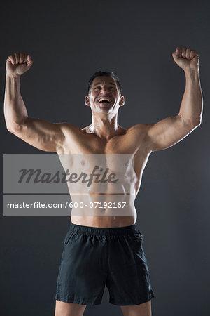 Portrait of Fit Man Cheering, Studio Shot