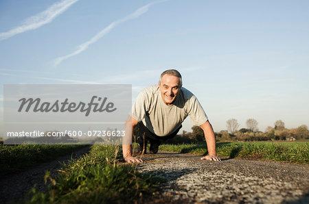 Senior Man doing Pushups Outdoors, Baden-Wurttemberg, Germany