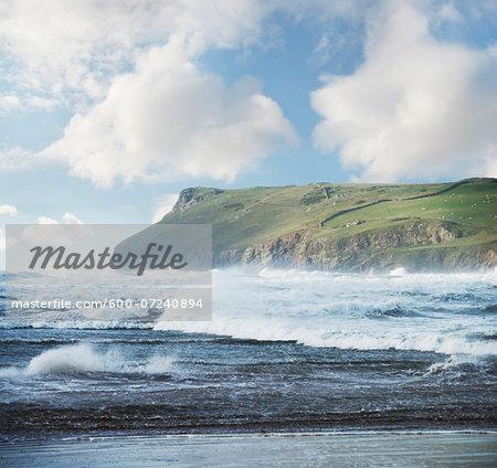 Scenic view of rough seas and headland, Polzeath, Cornwall, England