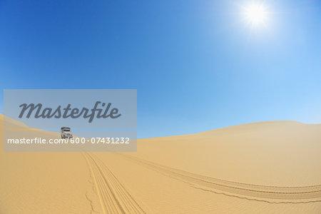 Four Wheel Drive Car in Desert with Blue Sky and Sun, Matruh, Great Sand Sea, Libyan Desert, Sahara Desert, Egypt, North Africa, Africa