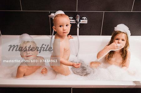 Three Children having Bath in Bathtub