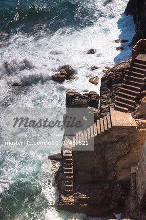 Steps down to Ocean, Riomaggiore, Cinque Terre, La Spezia District, Italian Riviera, Liguria, Italy