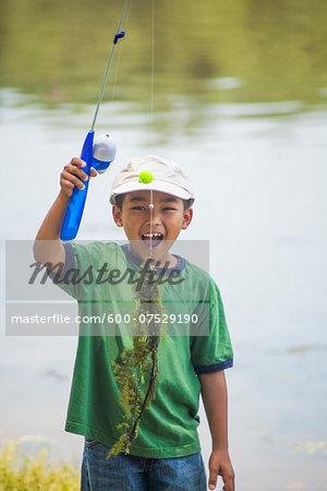 Boy with Fishing Line full of Pondweed, Lake Fairfax, Reston, Virginia, USA