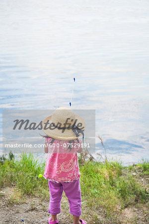 Back View of Girl in Sun Hat Fishing, Lake Fairfax, Reston, Virginia, USA