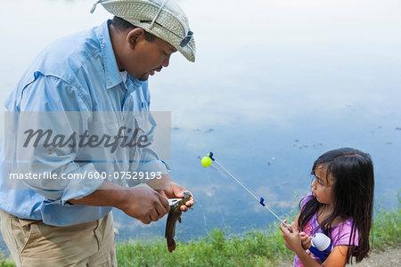 Father teaching Daughter how to Fish, Lake Fairfax, Reston, Virginia, USA
