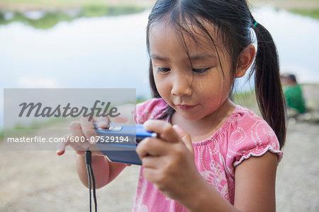 Cloes-up of Girl using Digital Camera, Lake Fairfax, Reston, Virginia, USA