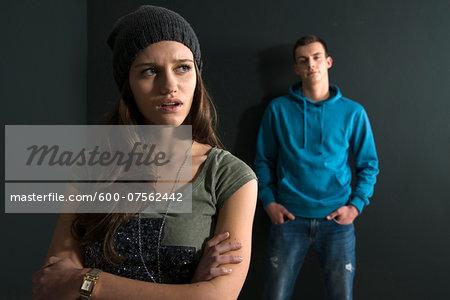 Teenage Girl and Young Man Arguing, Studio Shot