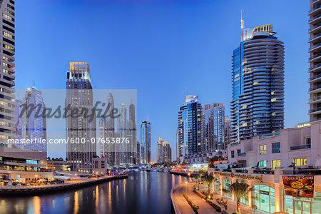 Skyscrapers at Dubai Marina illuminated at Dusk. Dubai, United Arab Emirates