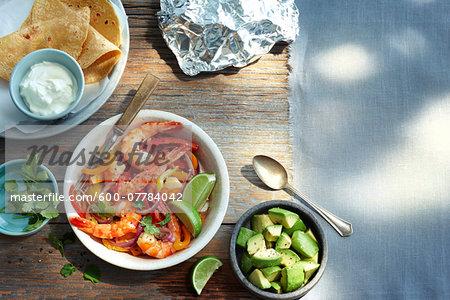 Overhead View of Corn Tortillas, Shrimp, Avocado and Sour Cream