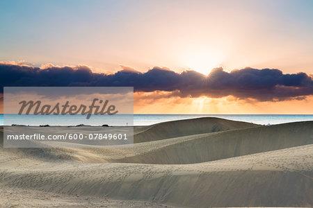 Dunes of Maspalomas at sunrise, with the Atlantic ocean in the distance, San Bartolome de Tirajana, Gran Canaria, Las Palmas, Canary Islands
