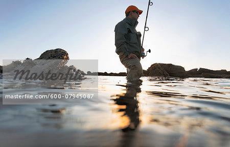 Man fishing along the coast of Rhode Island, USA