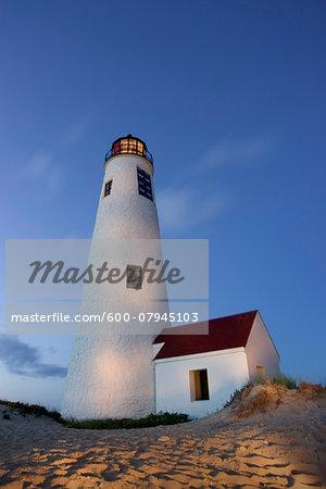 Great Point lighthouse, (also known as Nantucket Light) illuminated at dusk, Nantucket, Massachusetts, USA