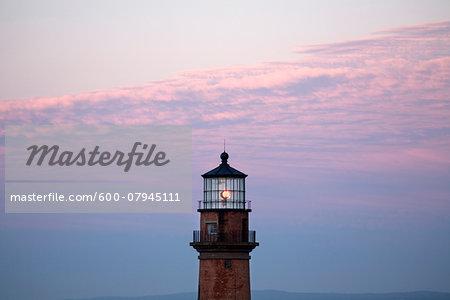 The Gay Head Lighthouse on the island of Martha's Vineyard illuminated at sunset, Massachusetts, USA.