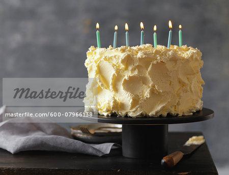 Vanilla Birthday Cake with Seven Candles Lit, Studio Shot