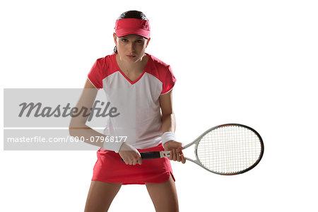 Portrait of Young Woman Playing Tennis, Studio Shot