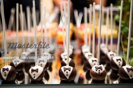 Close-up of Chocolate Tuxedo Lollipops on Dessert Table