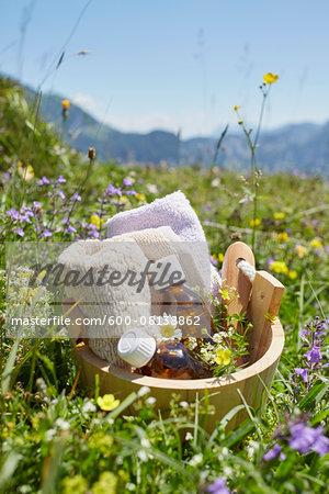 Bucket with Homeopathic Medicine in Flower Field, Strobl, Salzburger Land, Austria
