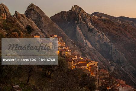 Scenic view of the sandstone rocks and mountain village of Castelmezzano at sunset, Lucanian Dolomites, Basilicata, Italy