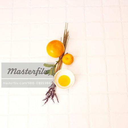 Aromatherapy Ingredients on White Tile Surface