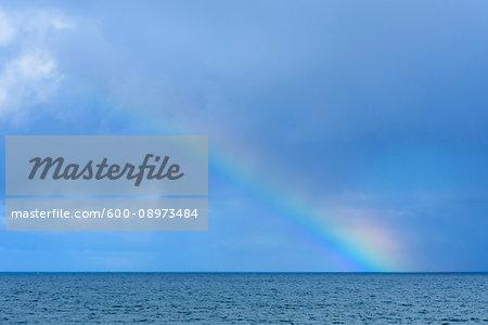 Rainbow over the North Atlantic Ocean at Mallaig in Scotland, United Kingdom