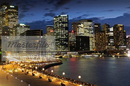 Seaside Promenade at the Circular Quay and Sydney skyline at dusk, Australia