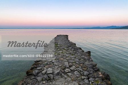 Angler jetty on Lake Garda (Lago di Garda) at dawn in Garda in Veneto, Italy