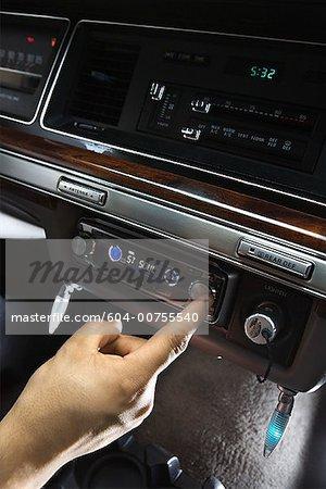 Man using car stereo/