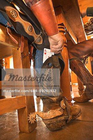Cowboy cheating at cards
