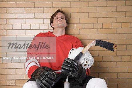 Serious hockey player sitting