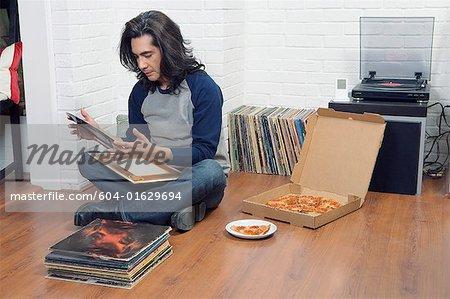 Man looking at records