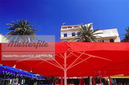 France, Corsica, Calvi, sunshade at the terrace of a cafe