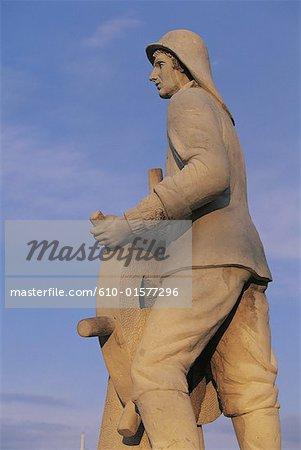 Spain, Balearic Islands, Ibiza, statue of a fisherman