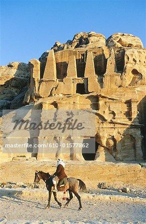 Jordan, Petra, Nabataean tombs, bedouin riding horse