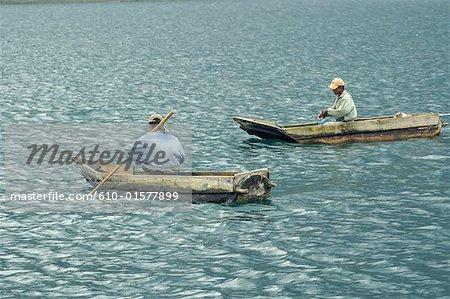 "Guatemala, Santiago Atitlan, fishermen in dugout called ""cayuco"""