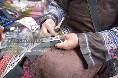 China, Beijing, Panjiayuan market, embroiderer