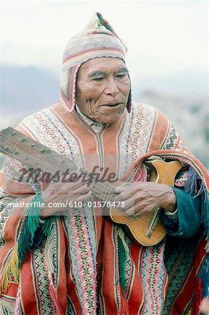 Peru, Cusco, Indian man playing the guitar