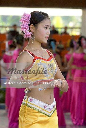 China, Yunnan, Xishuangbanna, near Jinghong, Dai Minority Park, young Dai dancer