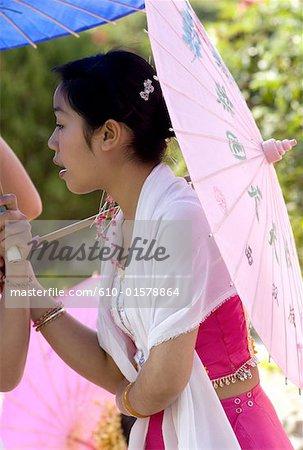 China, Yunnan, Xishuangbanna, near Jinghong, Dai Minority Park, young Dai woman