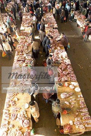 China, Yunnan, Xishuangbanna, Menghai, market, butchers